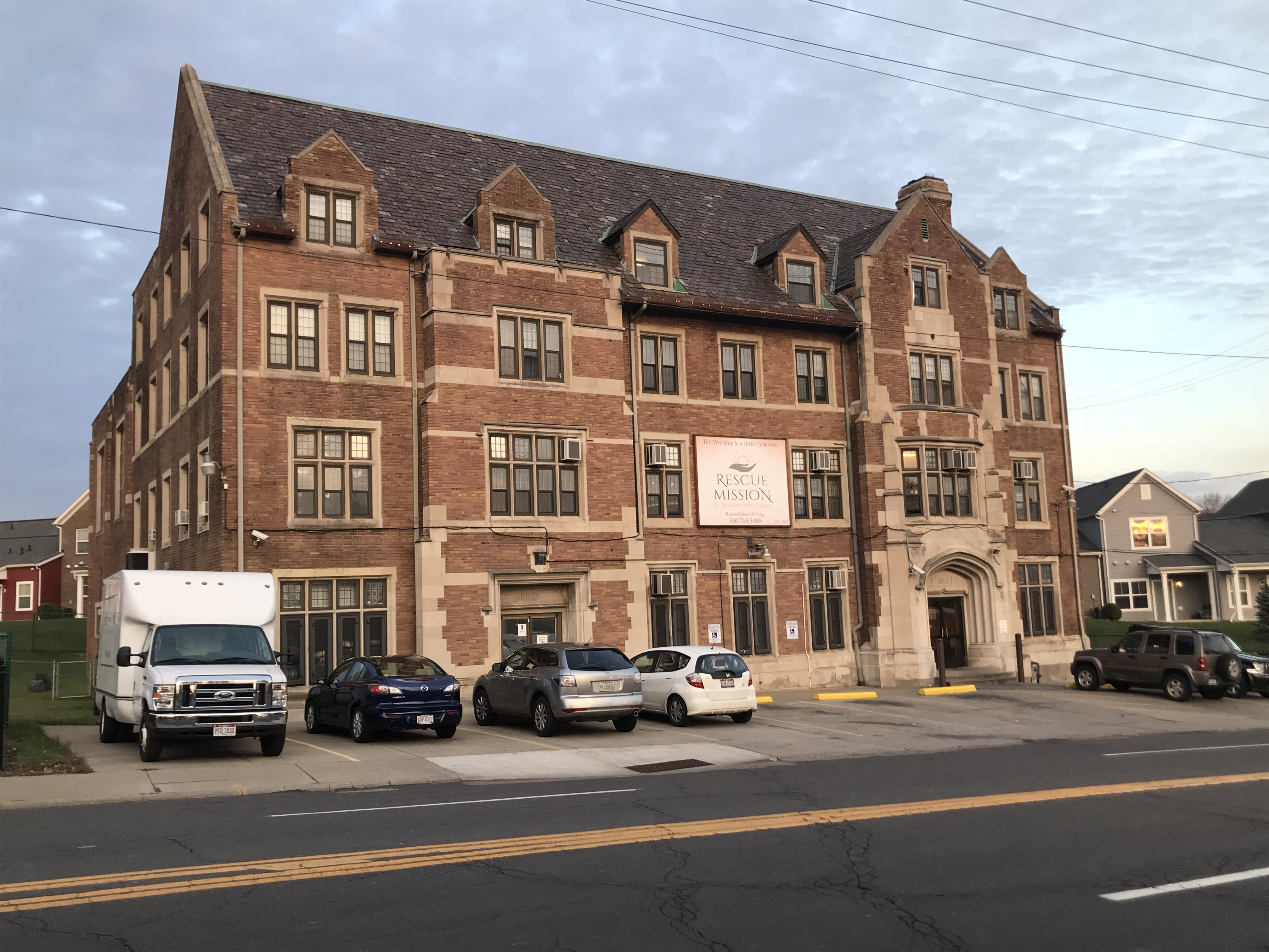 Image features a from-the-road photograph of the Rescue Mission building in Youngstown, Ohio, featured in the story Youngstown Rescue Mission's Intricate Ties to YSU, by Tyler Rothbauer.